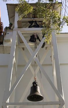 University of Georgia sheet metal mechanic Mark Collinsworth, left, and maintenance mechanic Robby McCurley, right and hidden, of the Physical Plant work on hoisting the bell on the Chapel on North Campus at the University of Georgia on Thursday, November 1, 2007. The yoke holing the bell was broken on Saturday, October 27th as students rang the bell after the Bulldogs win over the Florida Gators. Photo taken 11/1/2007. (University of Georgia/ University of Georgia, Andrew Davis Tucker).
