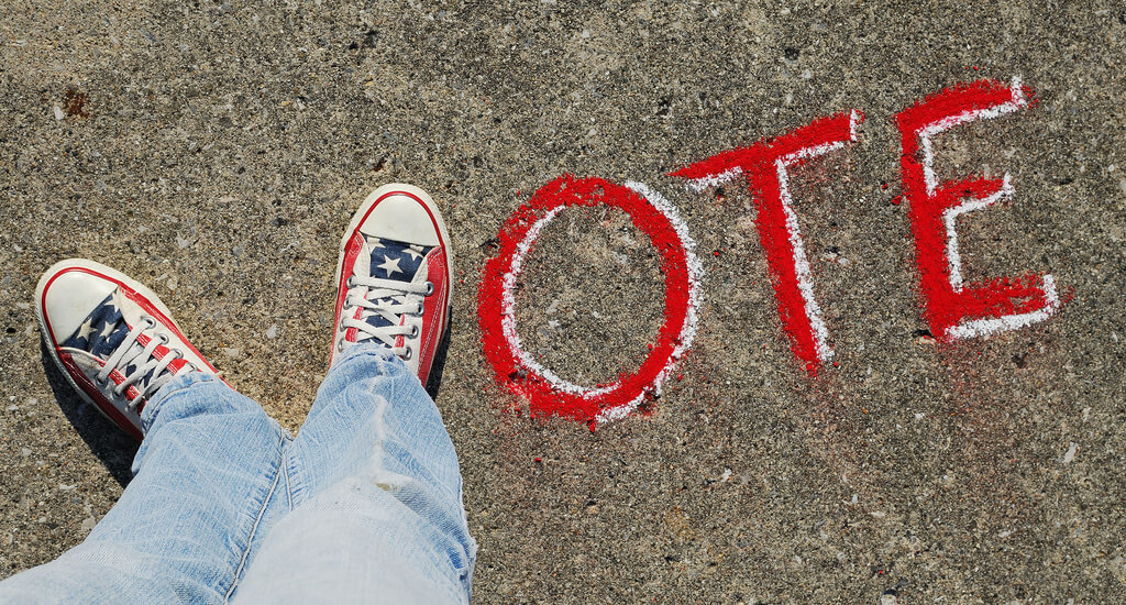 converse sneakers spell out vote with chalk