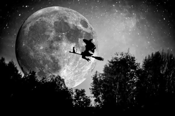 witch on broomstick in front of moon osu general education classes