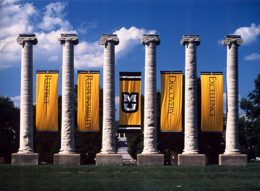 The Mizzou columns look impressive against a clear blue sky.
