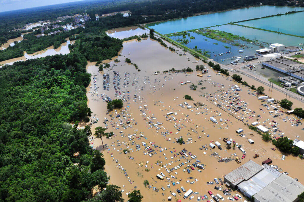 """A view from an MH-65 Dolphin helicopter shows flooding and devastation in Baton Rouge, La."""