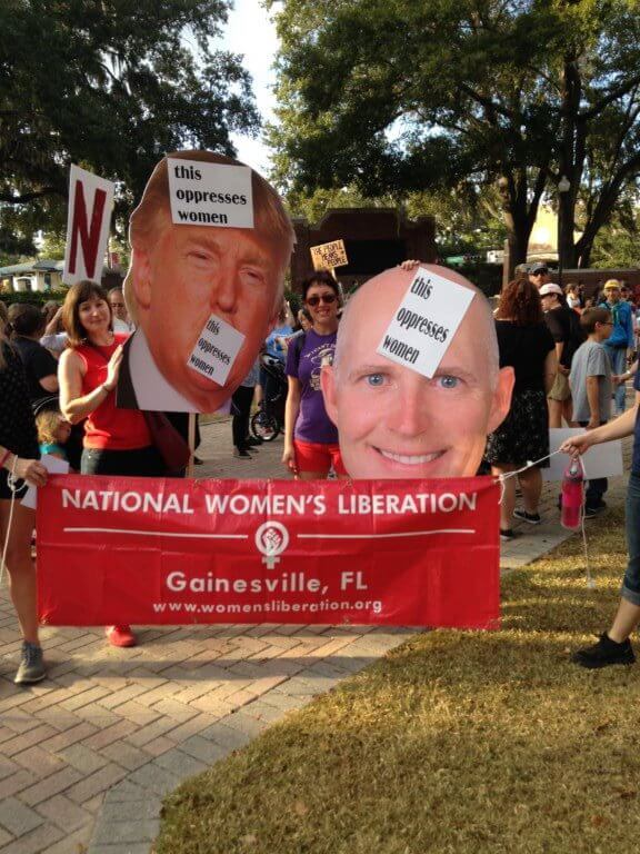 Trump and Scott posters at the Women's Lib protest in Gainesville.