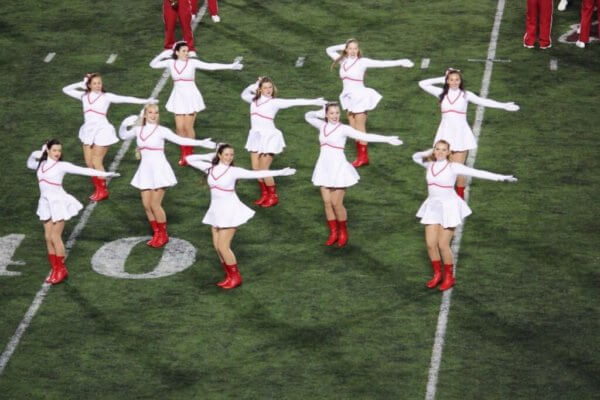 The Redsteppers, Indiana University's dance team, performing during halftime at Memorial Stadium.
