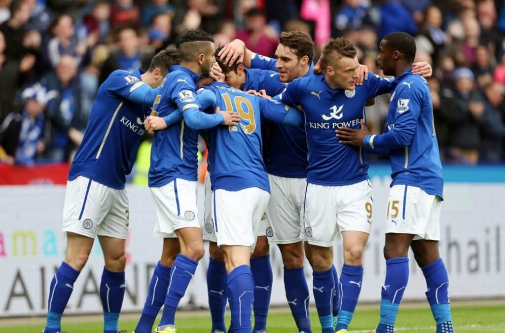 the Leicester City soccer team gathers on the field