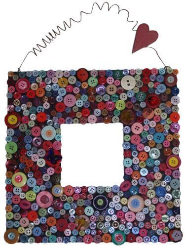 picture frame decorated with multicolored buttons for a DIY gift for parents