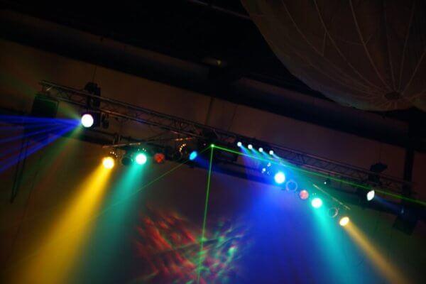 spotlights shine down on performers