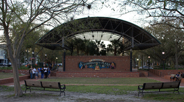 A view of the concert stage overlooking the grassy field in Bo Diddley Plaza in Gainesville