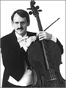 This picture shows Prof. Timothy Eddy from Juilliard with his cello in black and white.