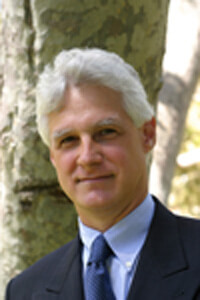 This picture shows Prof. Ian Krouse from University of California Los Angeles (UCLA) in a suit in front of a tree.