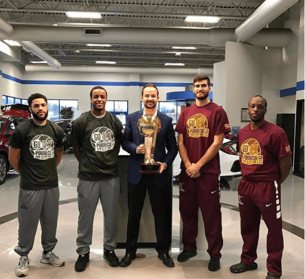 Mercyhurst athletes with a trophy