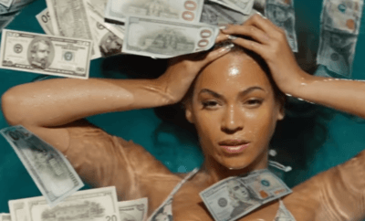 Beyonce in a pool of money