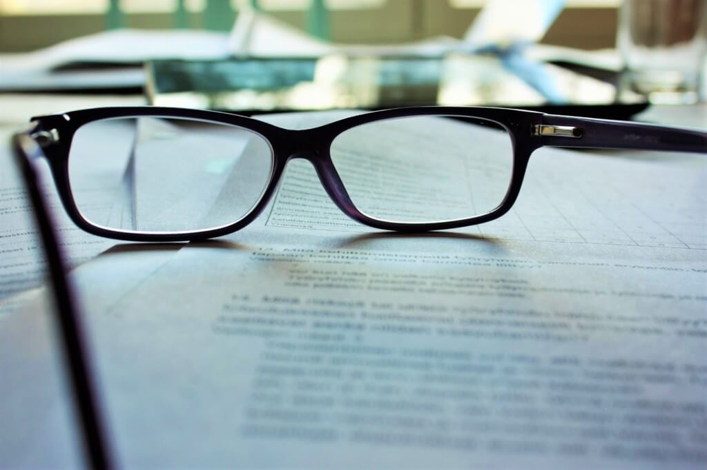 glasses on top of paper that shows your writing skills