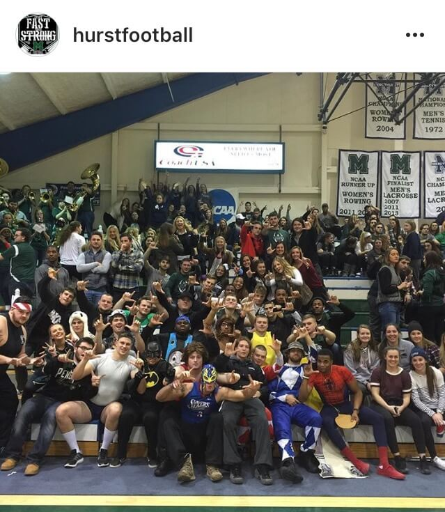 Mercyhurst football players at a basketball game
