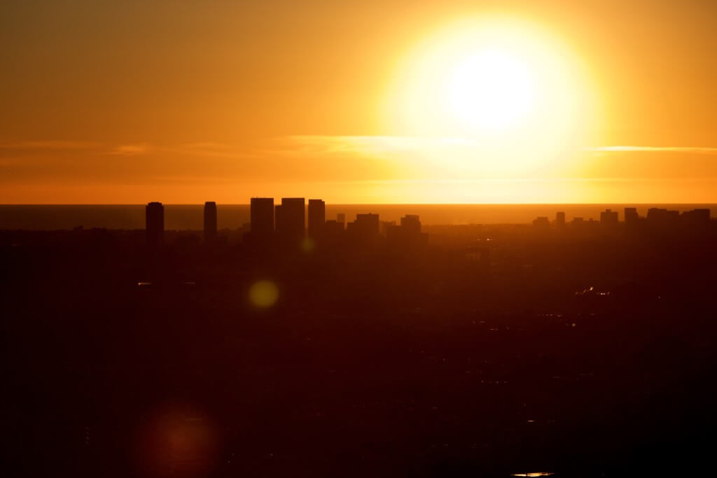the sun sets over the city