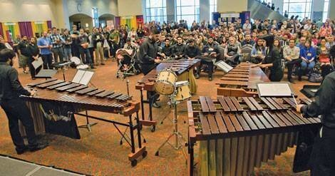 Musicians playing instruments in front of an audience for Texas Music Educators Association Clinic.