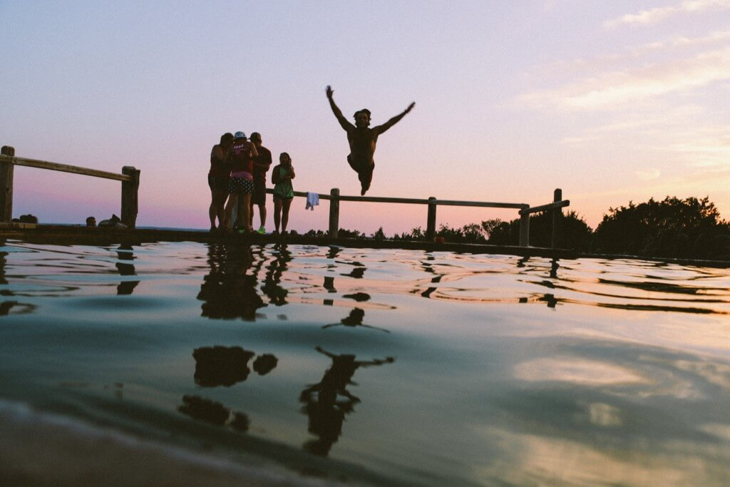 Jump into that water like a champ while your friends watch from the dock.