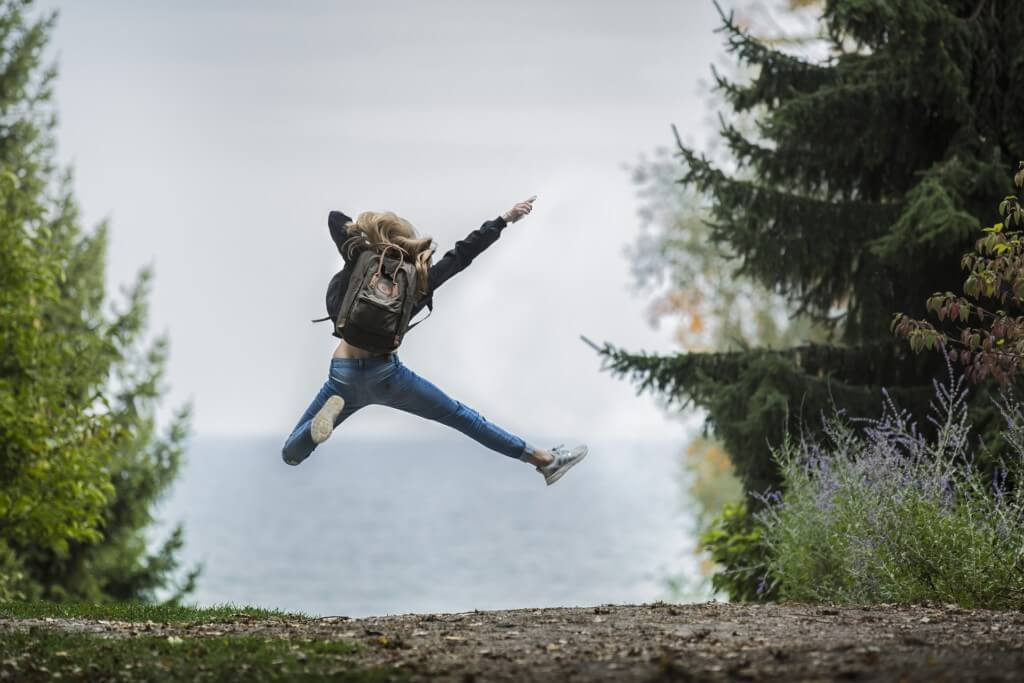 Jump for joy in nature on your solo spring break trip.