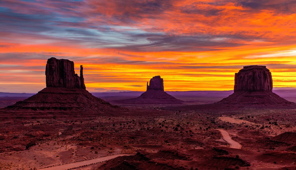Ride through Monument Valley and sleep in Navajo mud huts.
