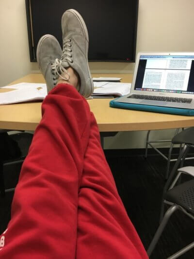 Sporting sweatpants in the study room