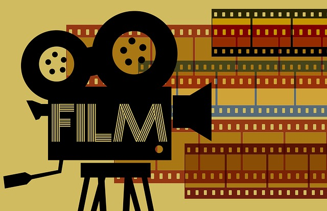 Cartoon of an old school film camera shooting out colored strips of film