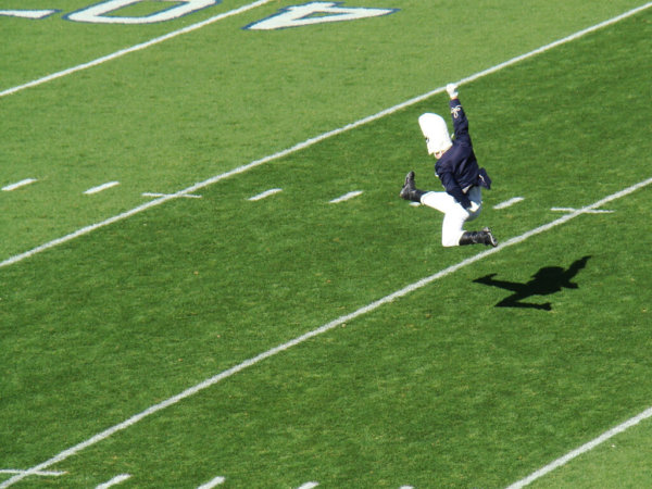 Picture of the drum major descending into his legendary split penn state football traditions
