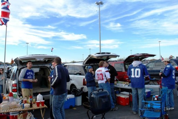 Penn Staters enjoying a day out in the sun, tailgating.