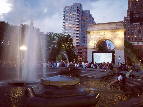 Films on the green and the classic Arc de Triomphe.