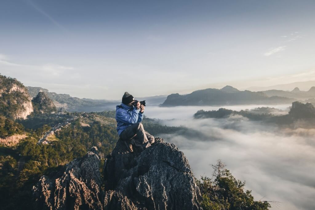 photographing a cliffside