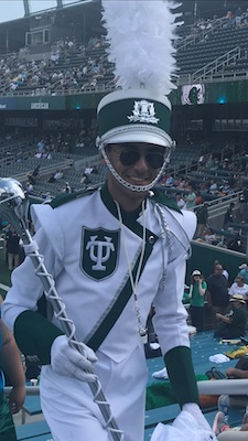 Marching band member in a tulane uniform
