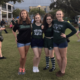 four girls arm in arm wearing Tulane gear