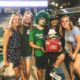 Five Tulane football fans pose with a basket of Canes prizes