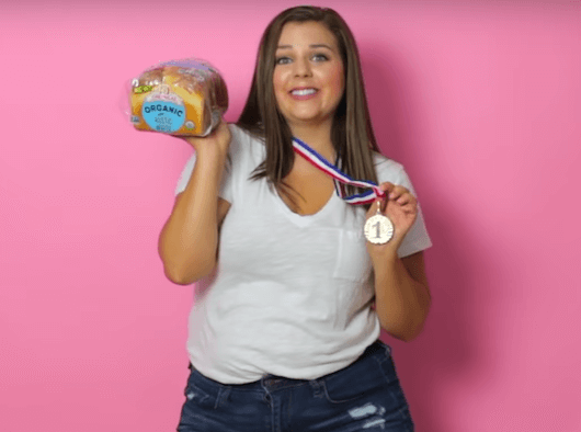woman holding bread and a gold medal halloween costume