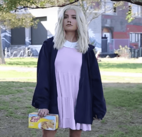 woman dressed as eleven from Stranger Things in a field halloween costume
