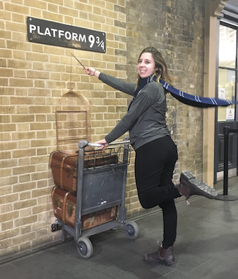 girl at Platform 9 3/4 with a blue scarf and a wand money exchange