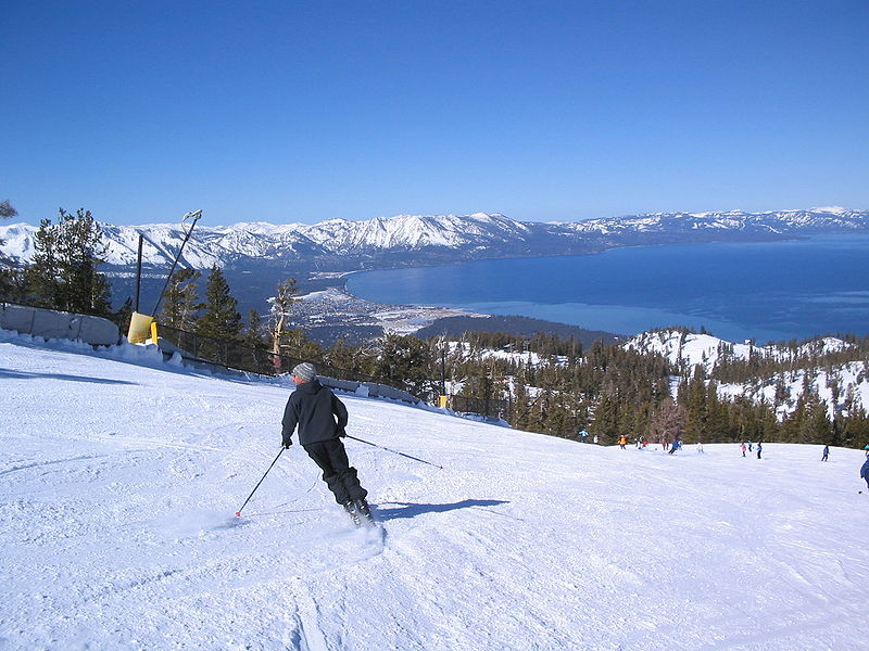 Sierra Nevada College Best Colleges for Skiers skiing down a mountain