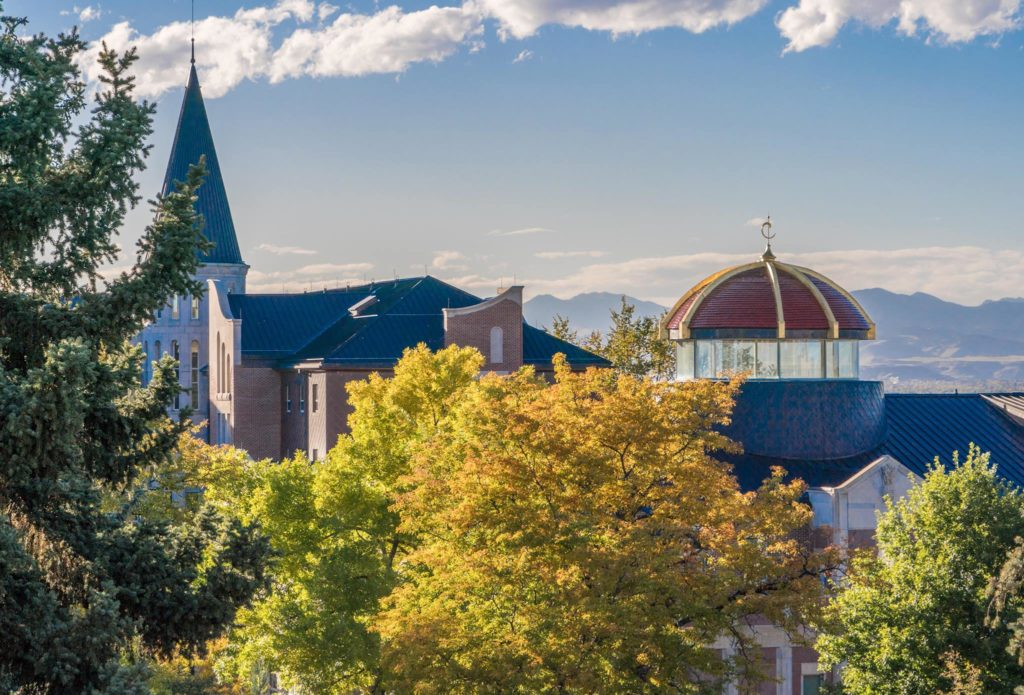 University of Denver campus with mountains in background Best Colleges For Skiers