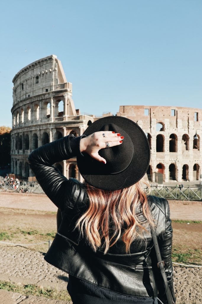 Girl looking at colosseum