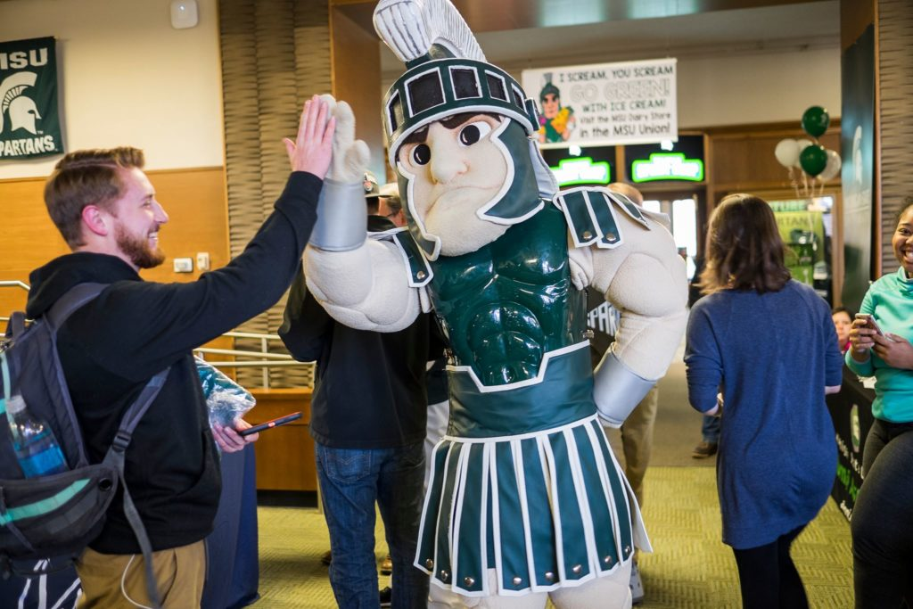 high five spartan mascot