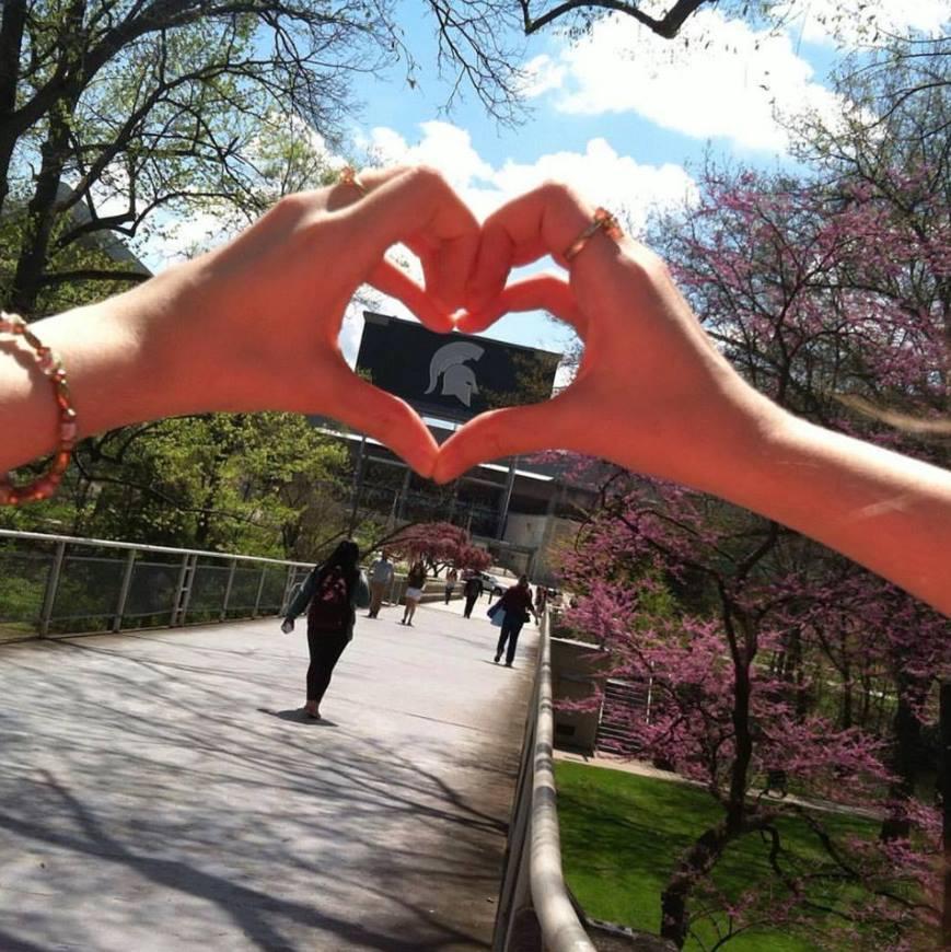 hand heart around spartan logo