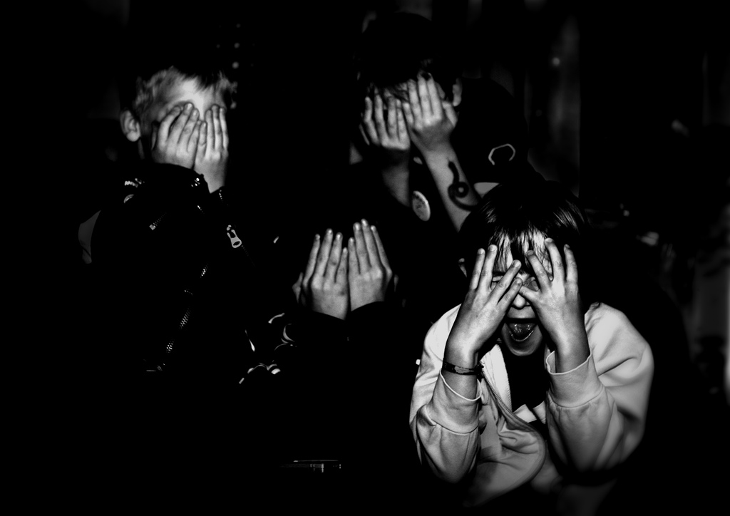 people covering their eyes