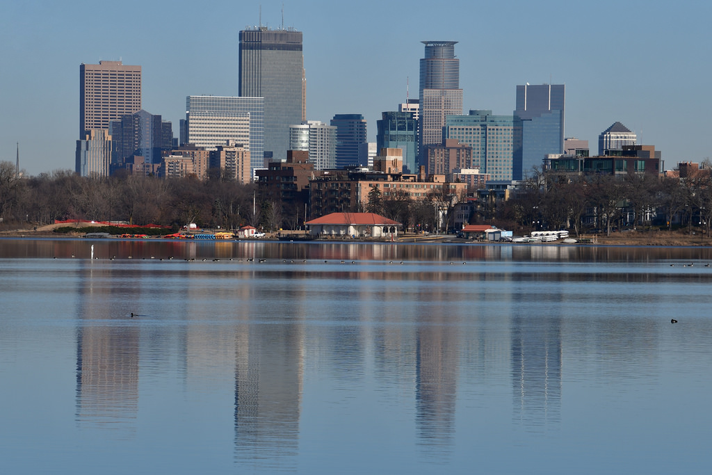 Lake with city skyline in background