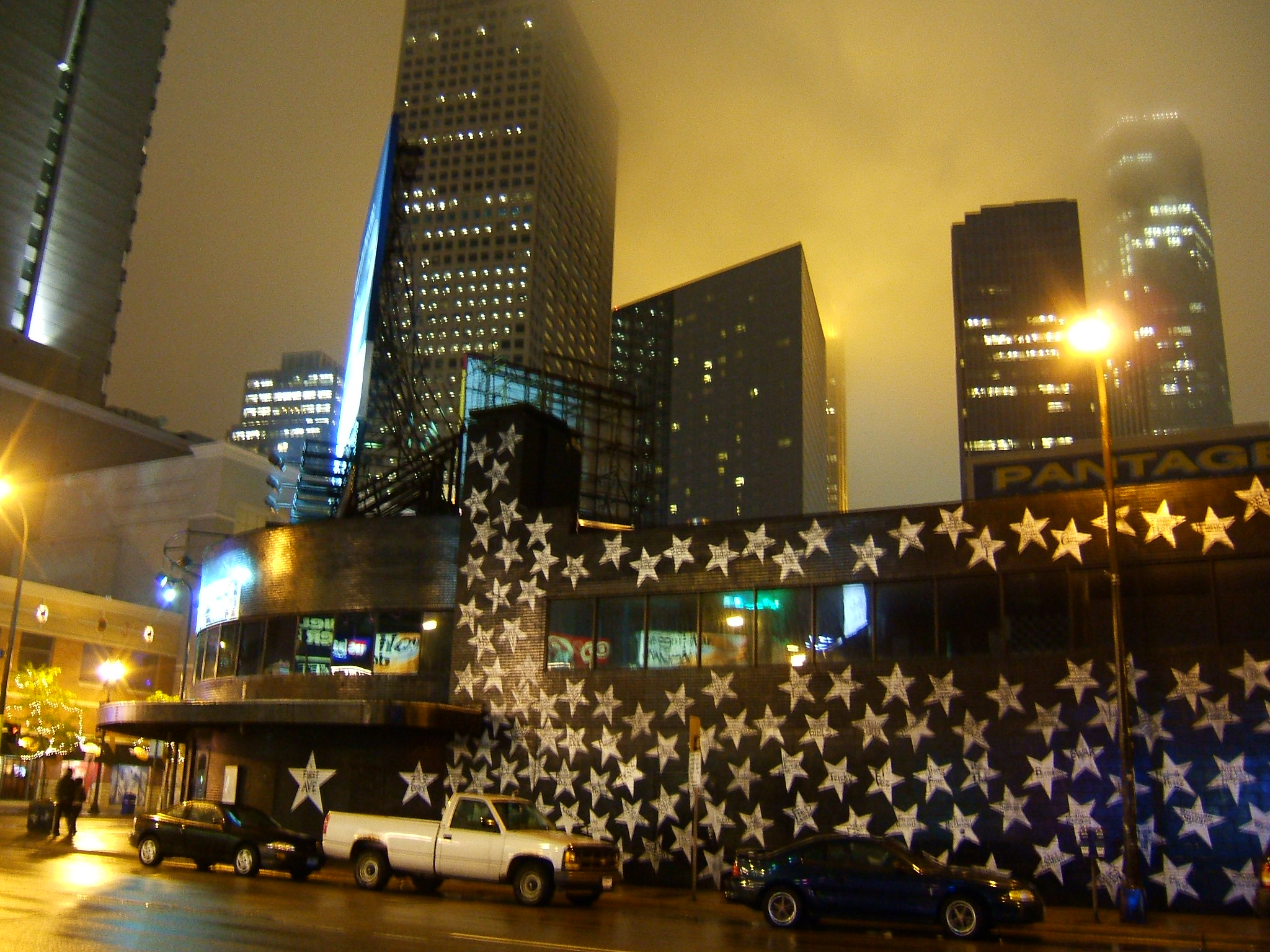 Outside of First Avenue at night with skyline in backdrop