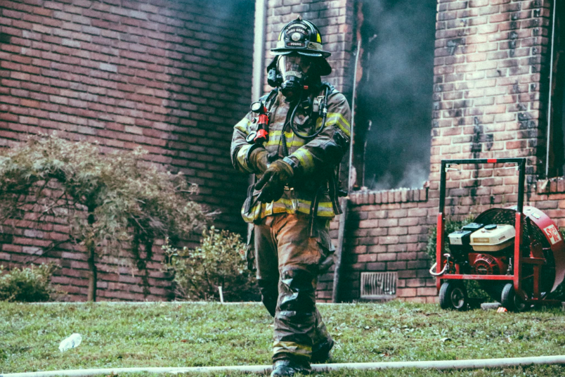 firefighter holding arm