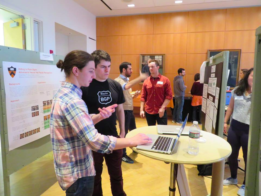 students explaining computer project