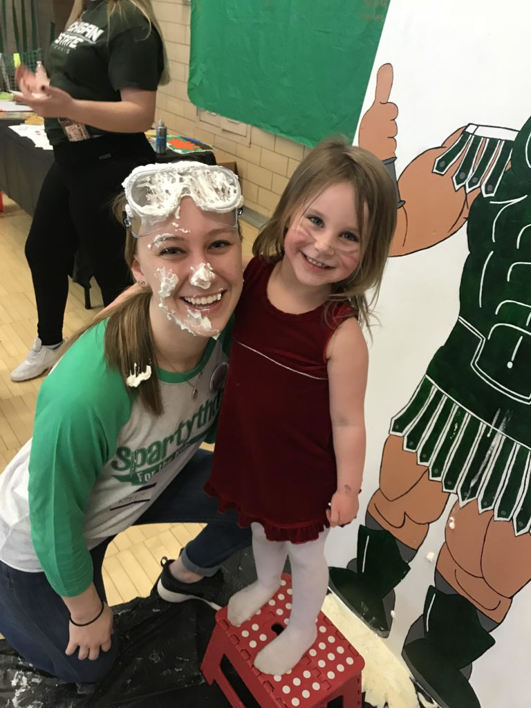 spartython pie face with little girl smiling