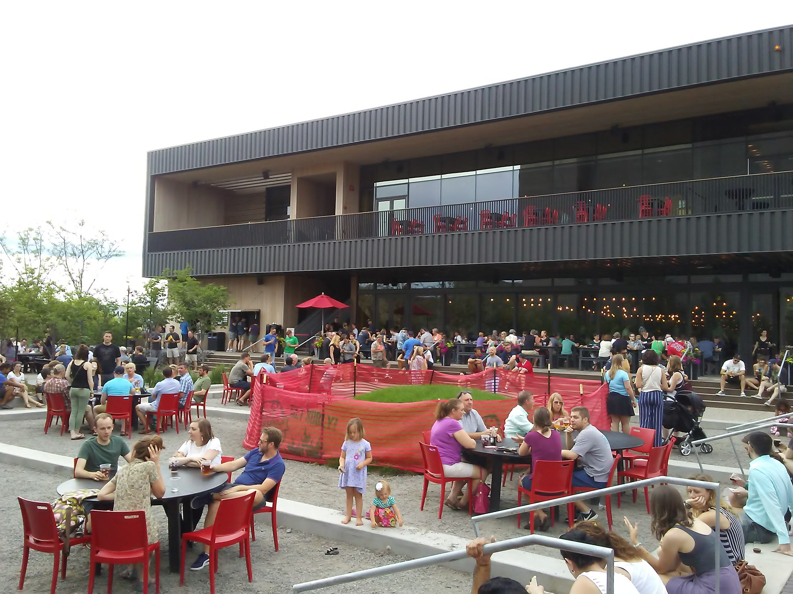 people sitting on large patio at Surly Brewing Company