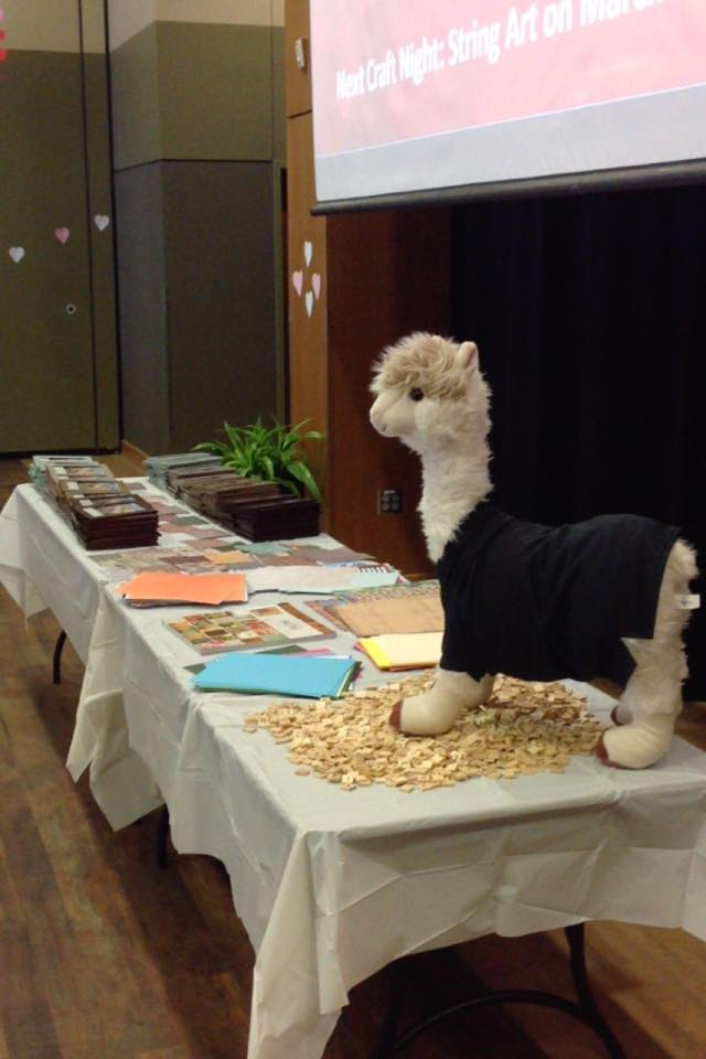 craft night table with llama stuffed animal