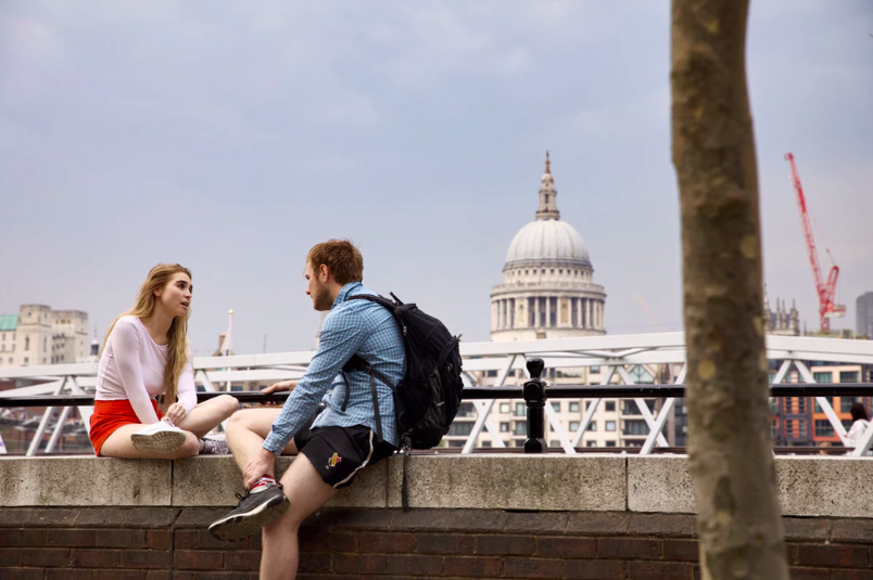 couple talking near capitol building millennial generation