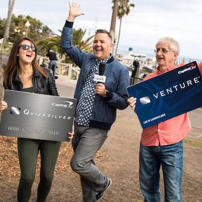People carrying large Capital One credit cards