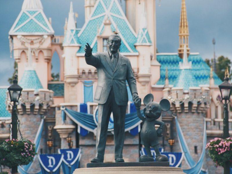 walt disney with mickey statue
